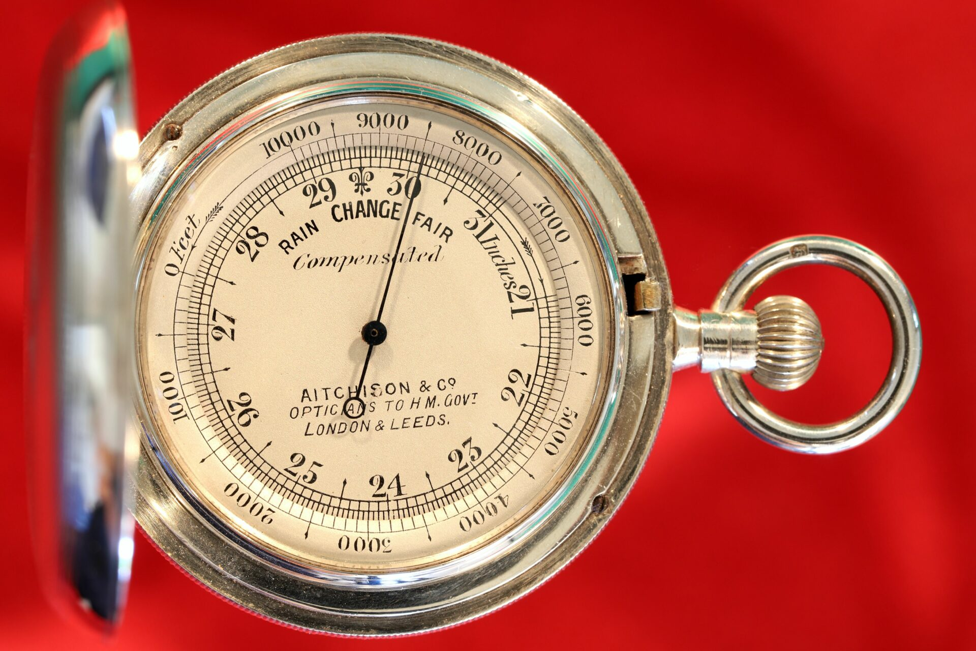 Image of dial of silver hunter cased pocket barometer in silver case by Albert Thomas Oliver, retailed by Aitchison & Co c1905
