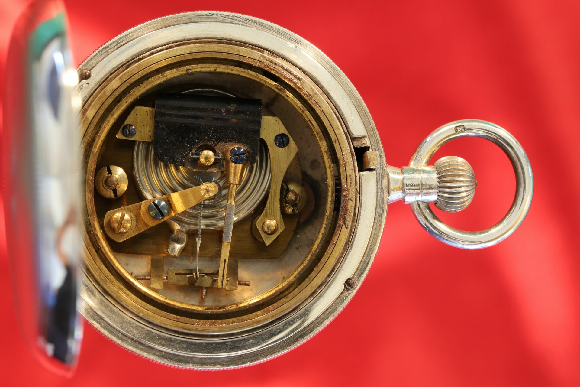 Image of movement of silver hunter cased pocket barometer in silver case by Albert Thomas Oliver, retailed by Aitchison & Co c1905