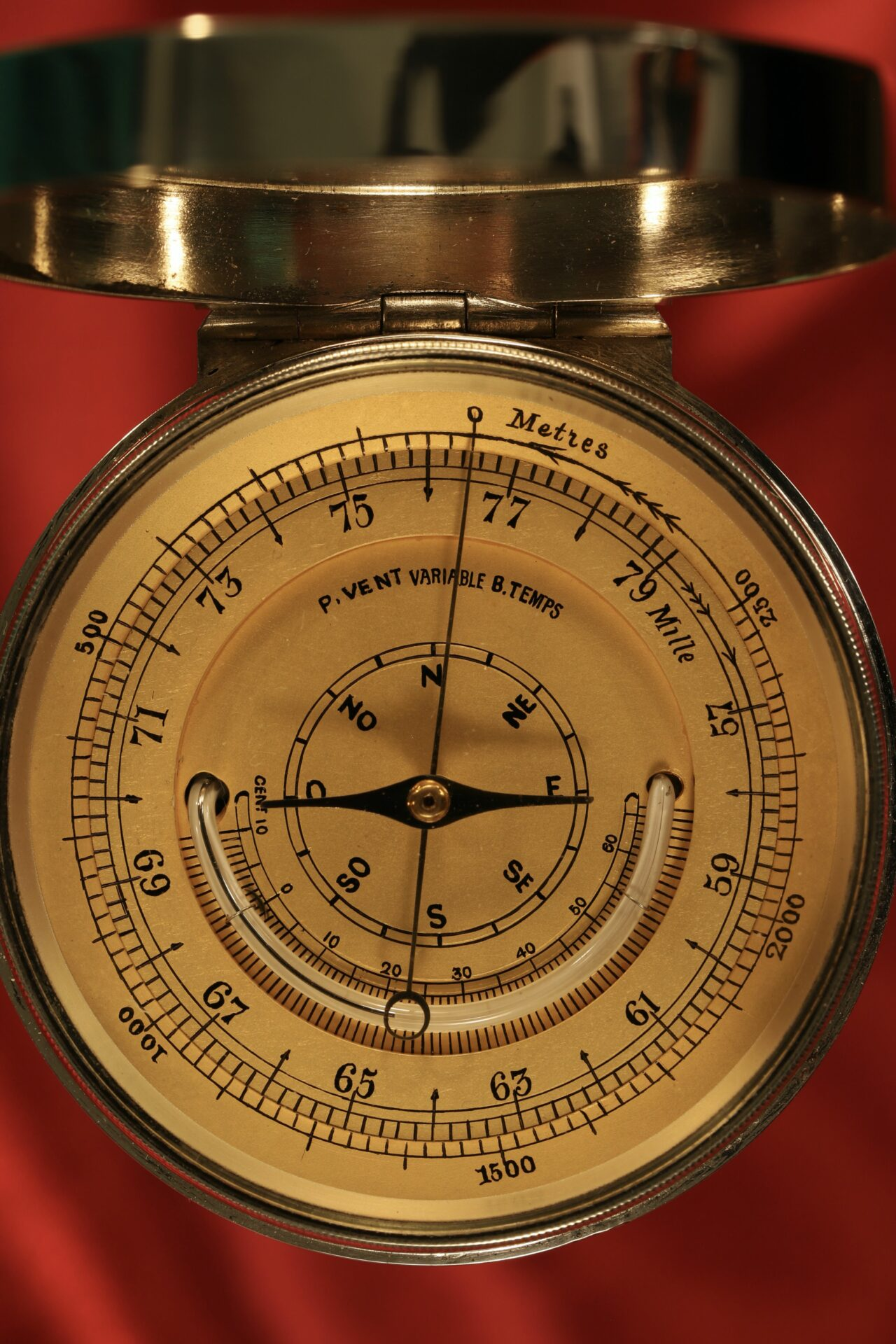 Close up of dial and thermometer of Clark Silver Pocket Barometer Thermometer Compass Compendium c1888