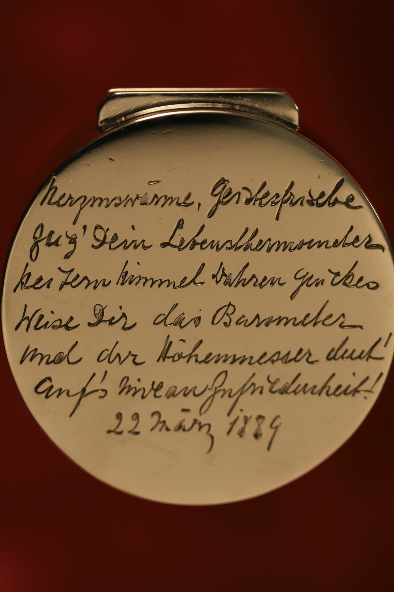 Close up of German inscription on Clark Silver Pocket Barometer Thermometer Compass Compendium c1888