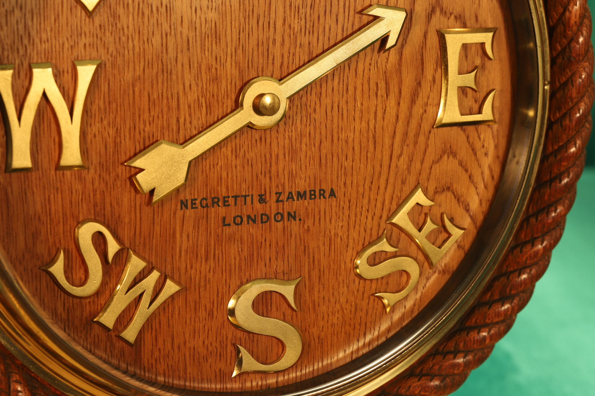 A front shot close up of the lower part of a substantial and beautiful Negretti & Zambra wind indicator