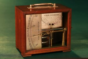 Image of the cased French Atmos Barometer c1875 taken from the left