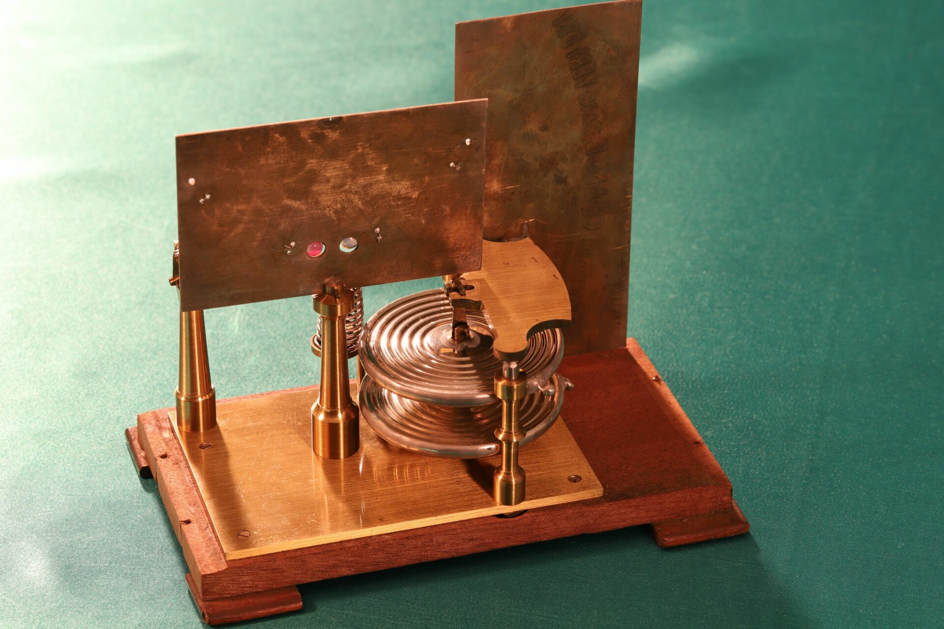 Image of back of dials and movement of French Atmos Barometer c1875
