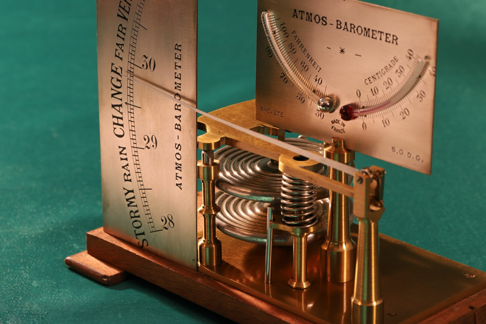 Close up of dials and movement of French Atmos Barometer c1875