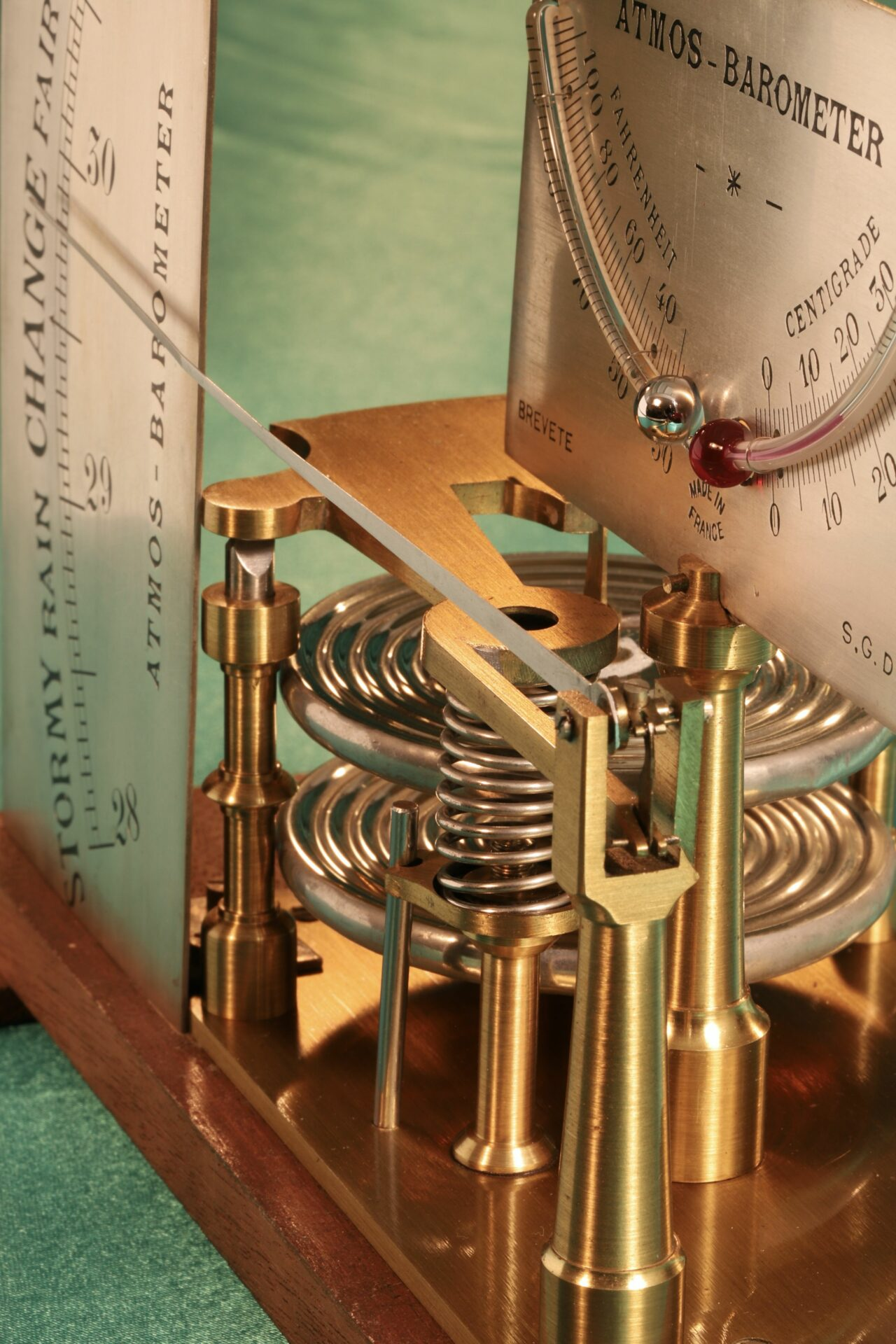 Close up of dials and movement of French Atmos Barometer c1875, showing the thermometers clearly