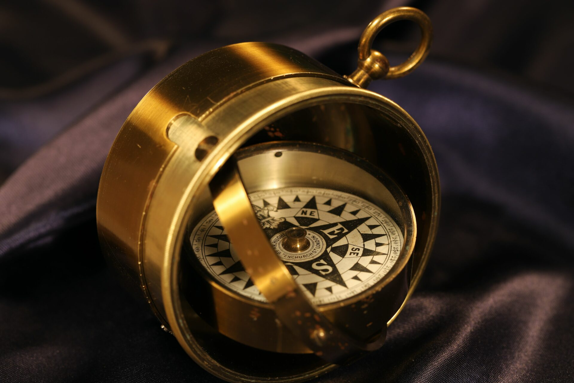 Close up of Barker Gimballed Nautical Compass for Hughes c1880 with open telescopic sides and gimbal showing