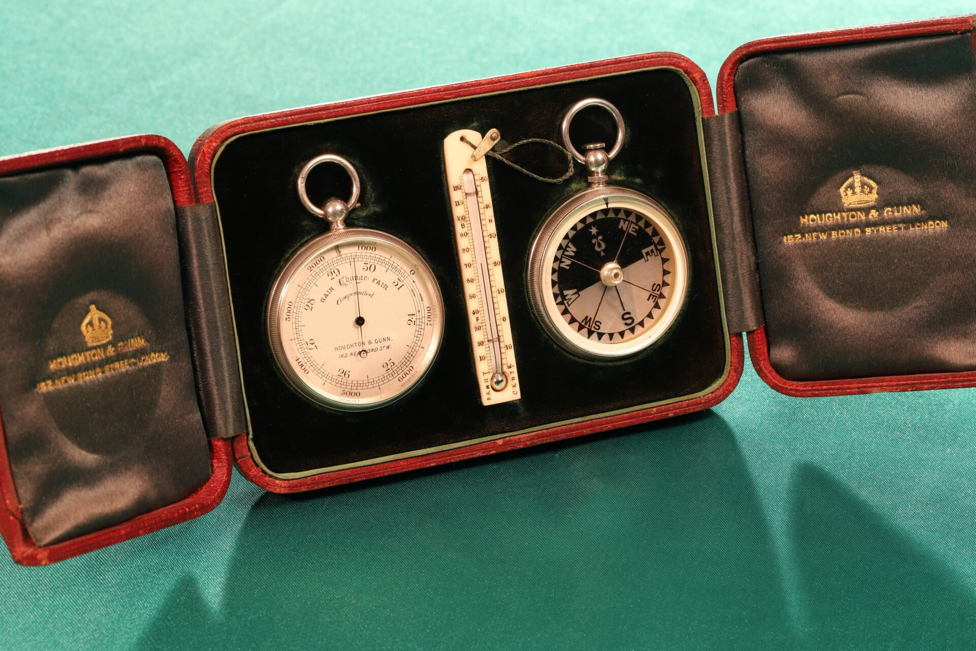 Image of the inside of Houghton & Gunn Silver Travel Compendium c1895 showing pocket barometer, thermometer and compass and the retailer's marks