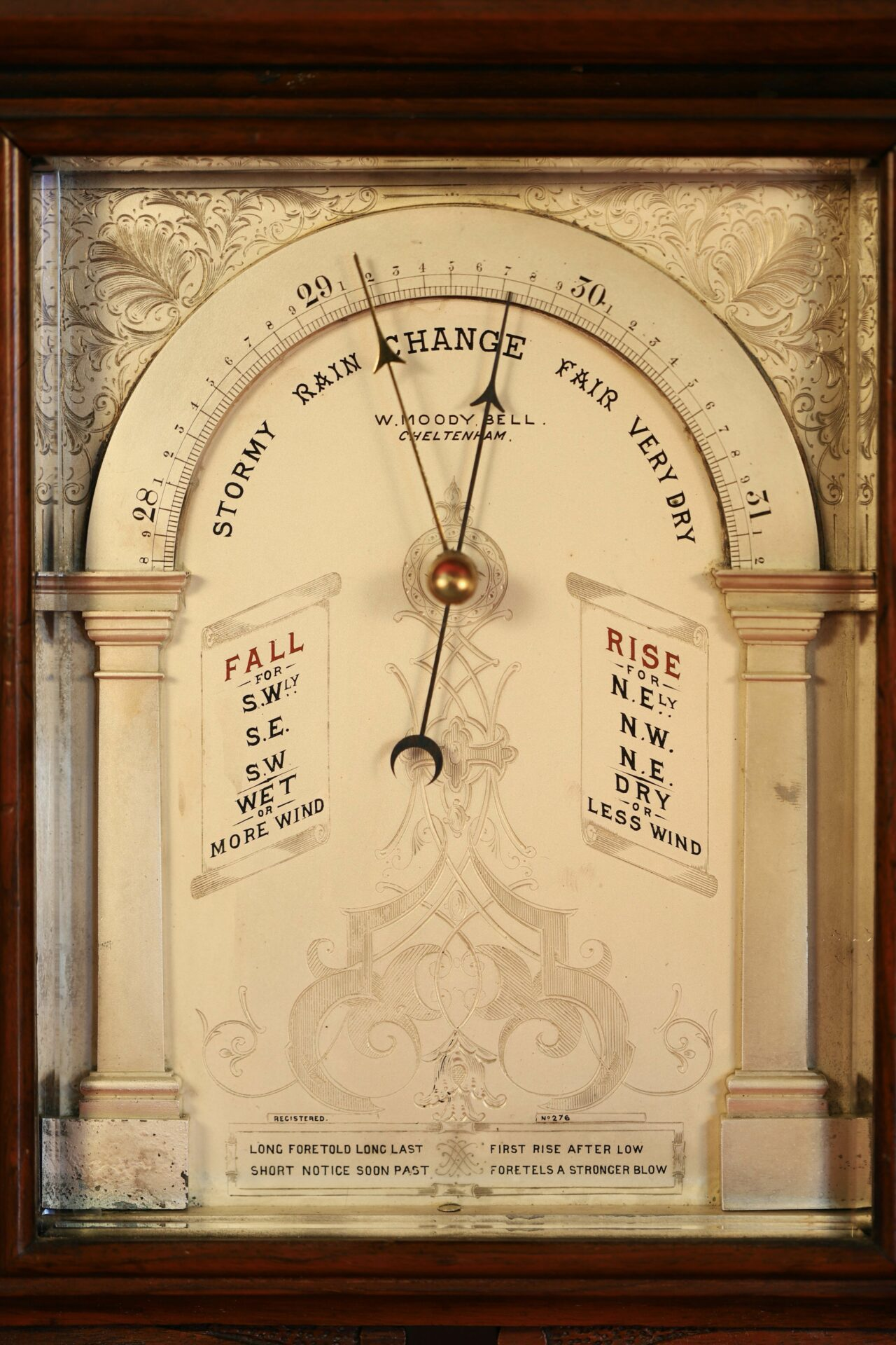 Image of dial of Moody Bell Table Barometer c1880 showing decoration and wording