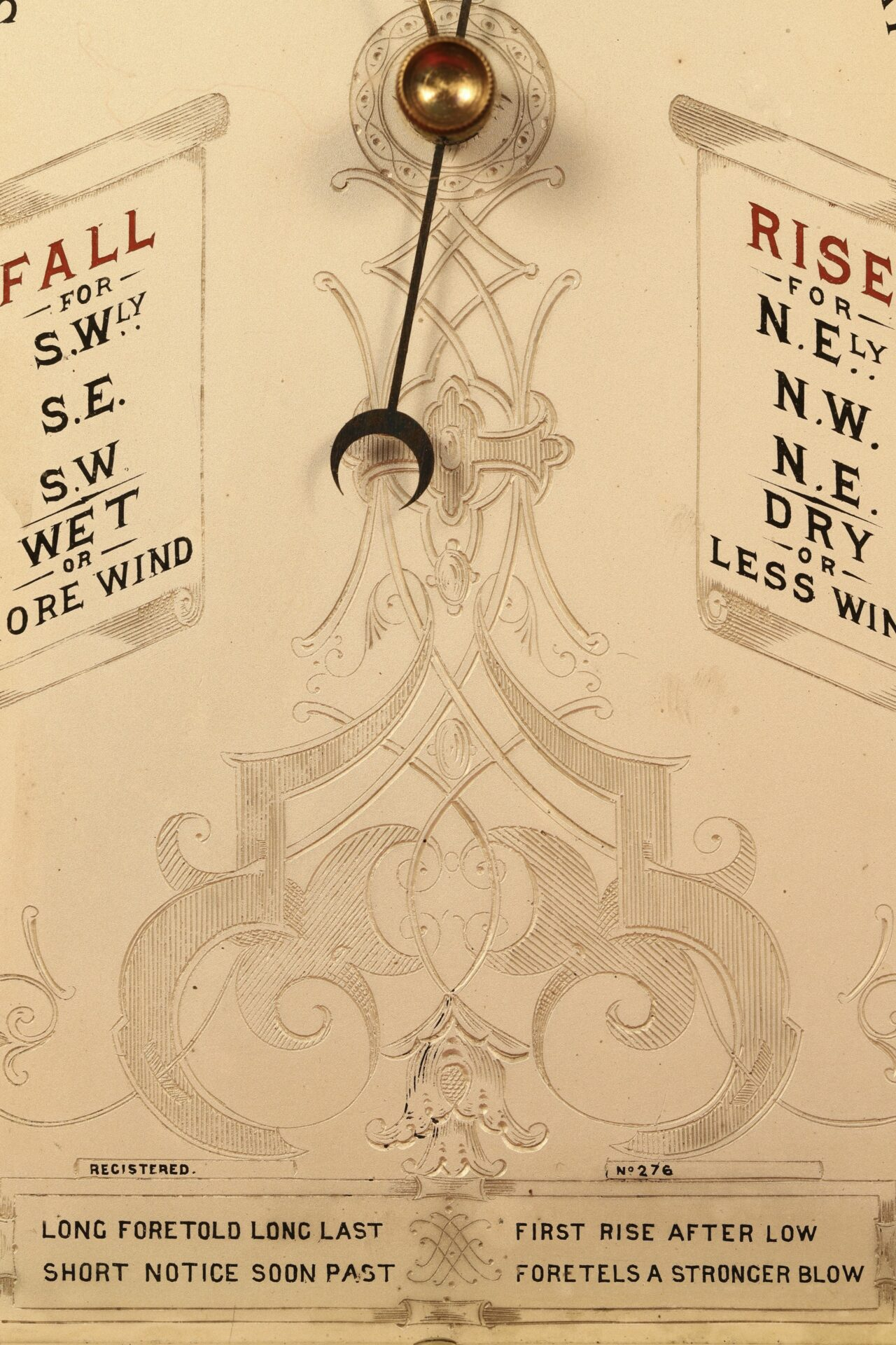 Close up of decoration to centre of dial of Moody Bell Table Barometer c1880