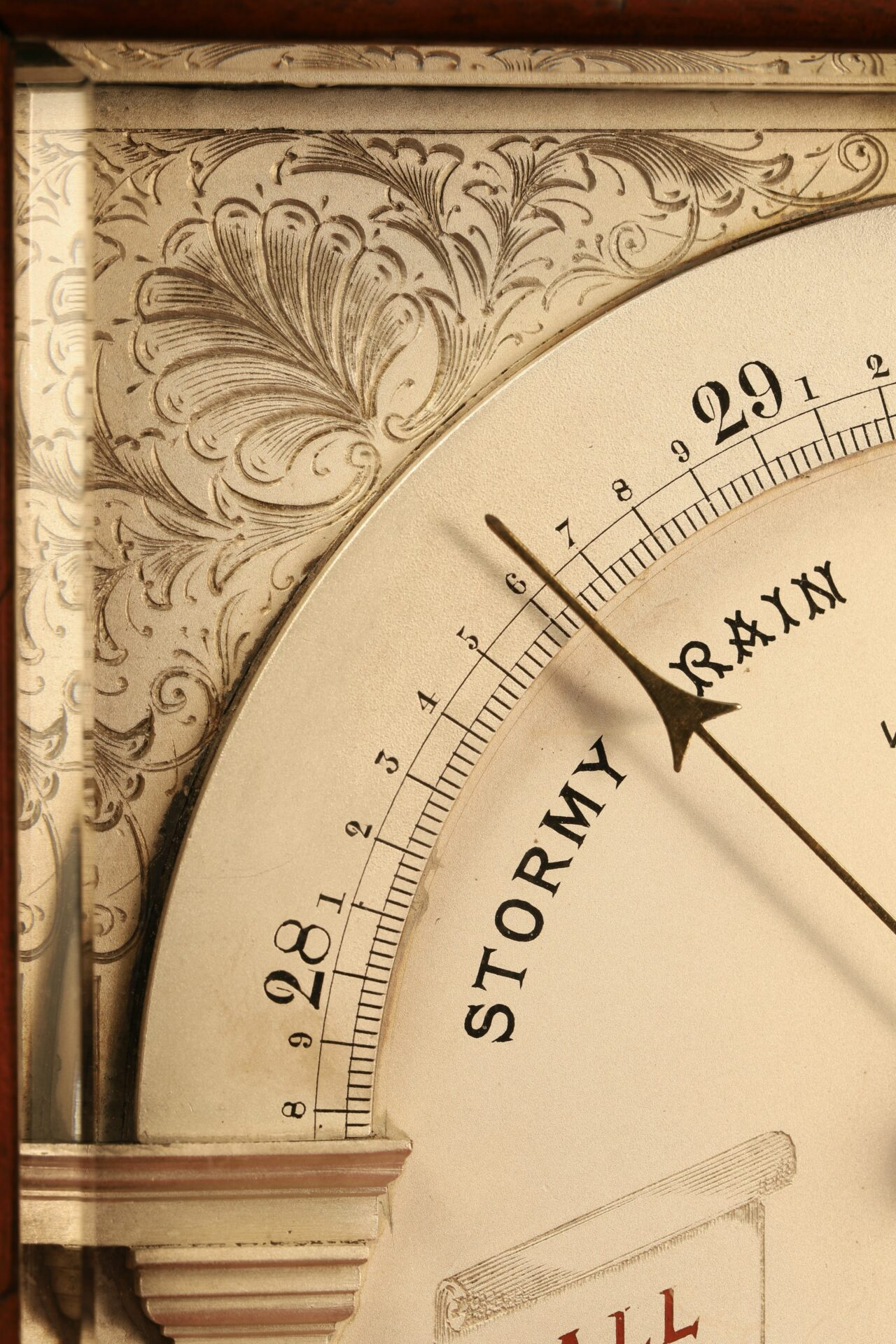 Close up of decoration to corner of dial of Moody Bell Table Barometer c1880