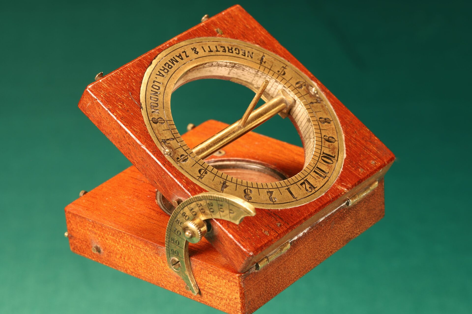 Image of open Francis Barker Equinoctial Compass Retailed by Negretti & Zambra c1870 with gnomon raised taken from righthandside