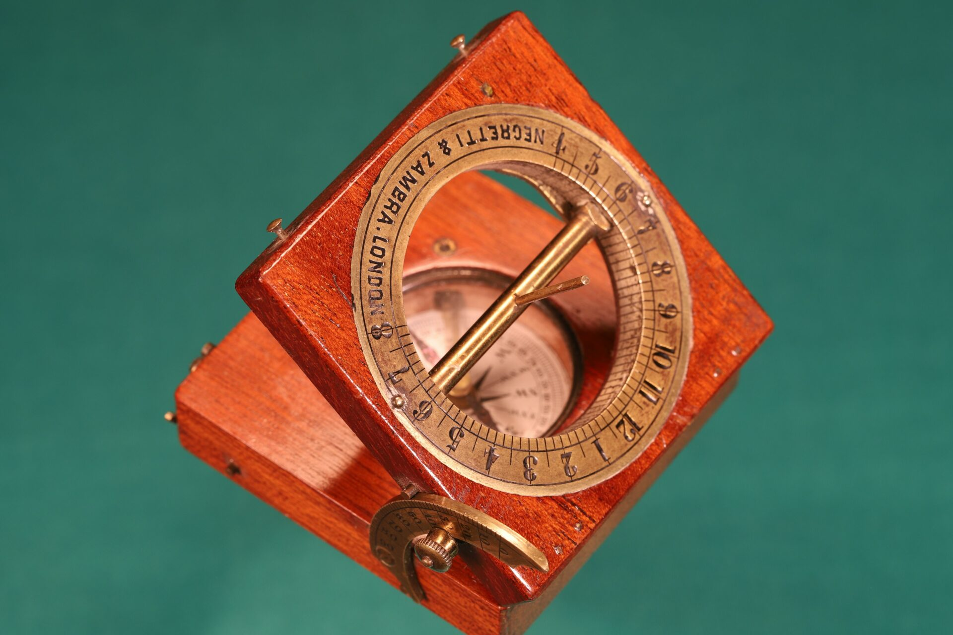 Image of open Francis Barker Equinoctial Compass Retailed by Negretti & Zambra c1870 with gnomon raised taken from above
