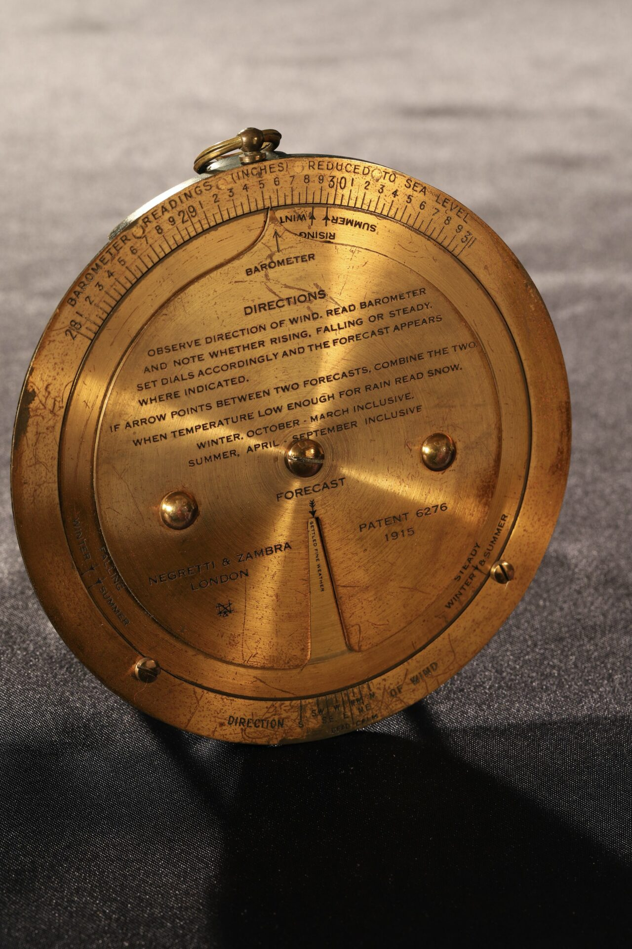 Image of brass forecaster from Negretti & Zambra Forecasting Aneroid No 9071 c1920 taken from above left