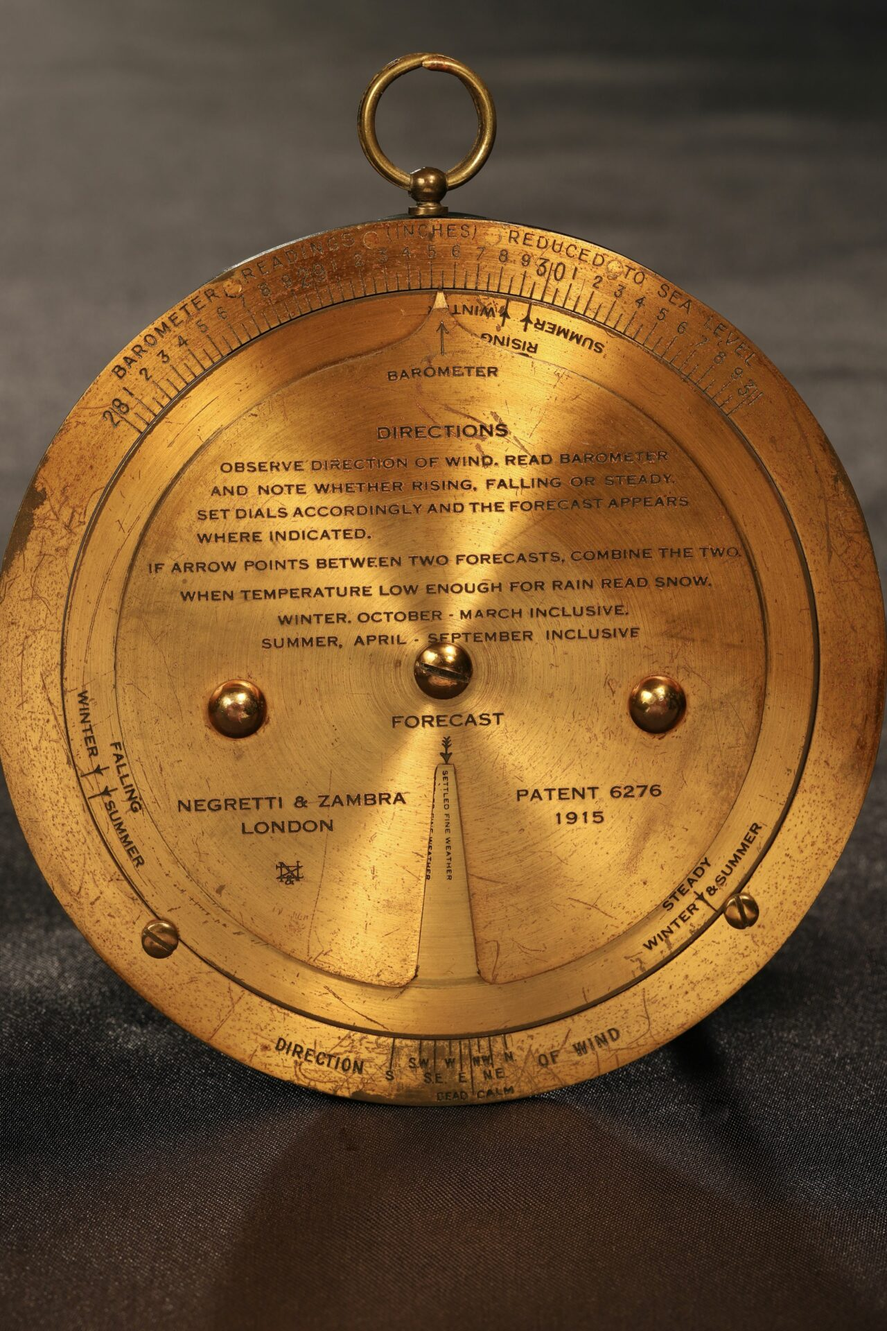 Image of front of brass forecaster from Negretti & Zambra Forecasting Aneroid No 9071 c1920