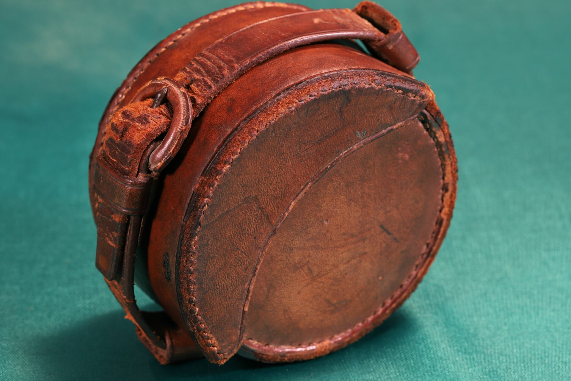 Image of closed leather travel case for Oxidised Brass Pocket Sextant c1890