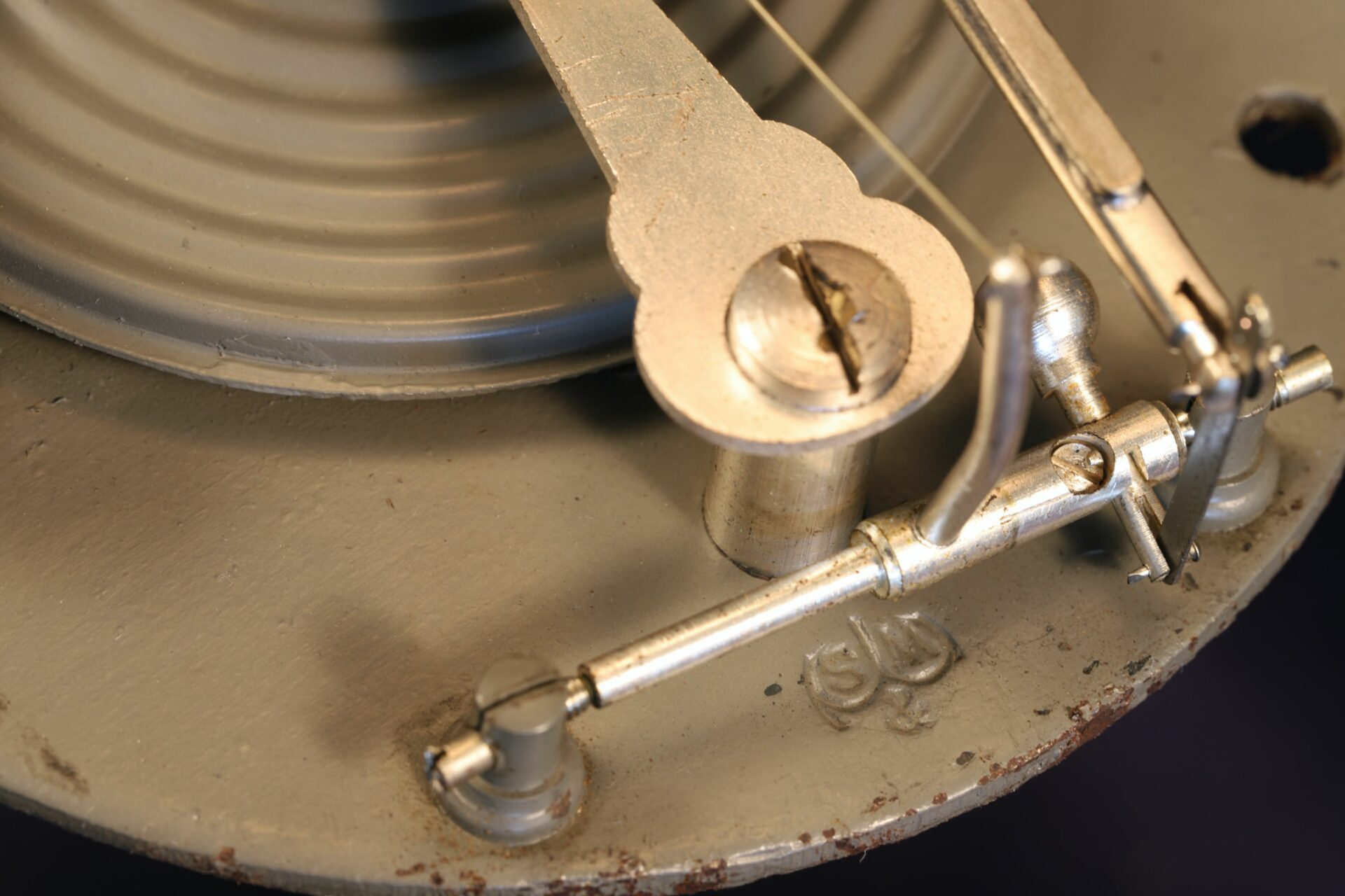Close up of S&M logo from movement of Short & Mason Hexagonal Stormoguide Barometer c1935