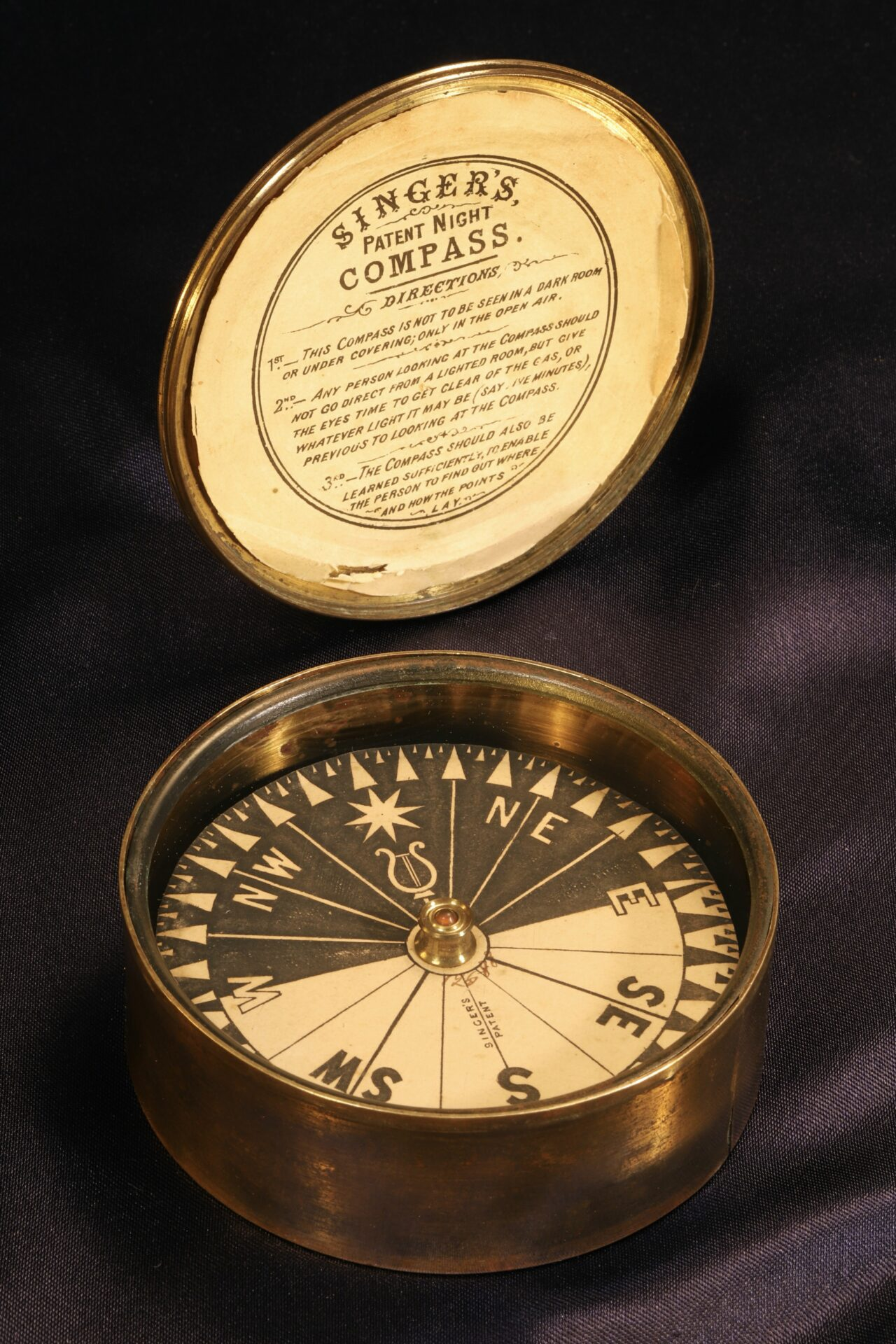 Image of Singers Patent Night Compass No 12588 c1865 showing dial and inside lid with label