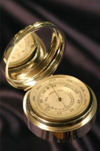 Image taken from left of the open case for Silver Pocket Barometer Compendium by Thornhill c1899 showing the dial and the inner lid hallmarks