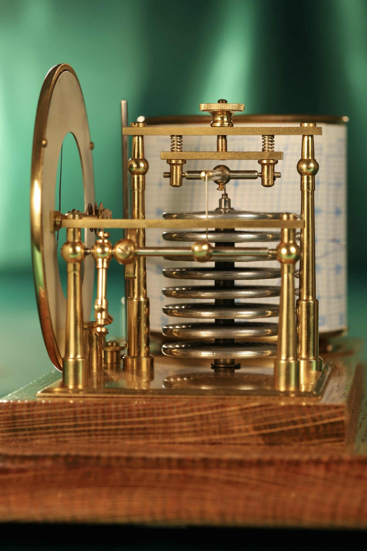 Close up of Short & Mason Tycos Drum Barograph with Dial No 5431 c1930 with case lid removed, taken end on focusing on capsule stack and adjustment screw above