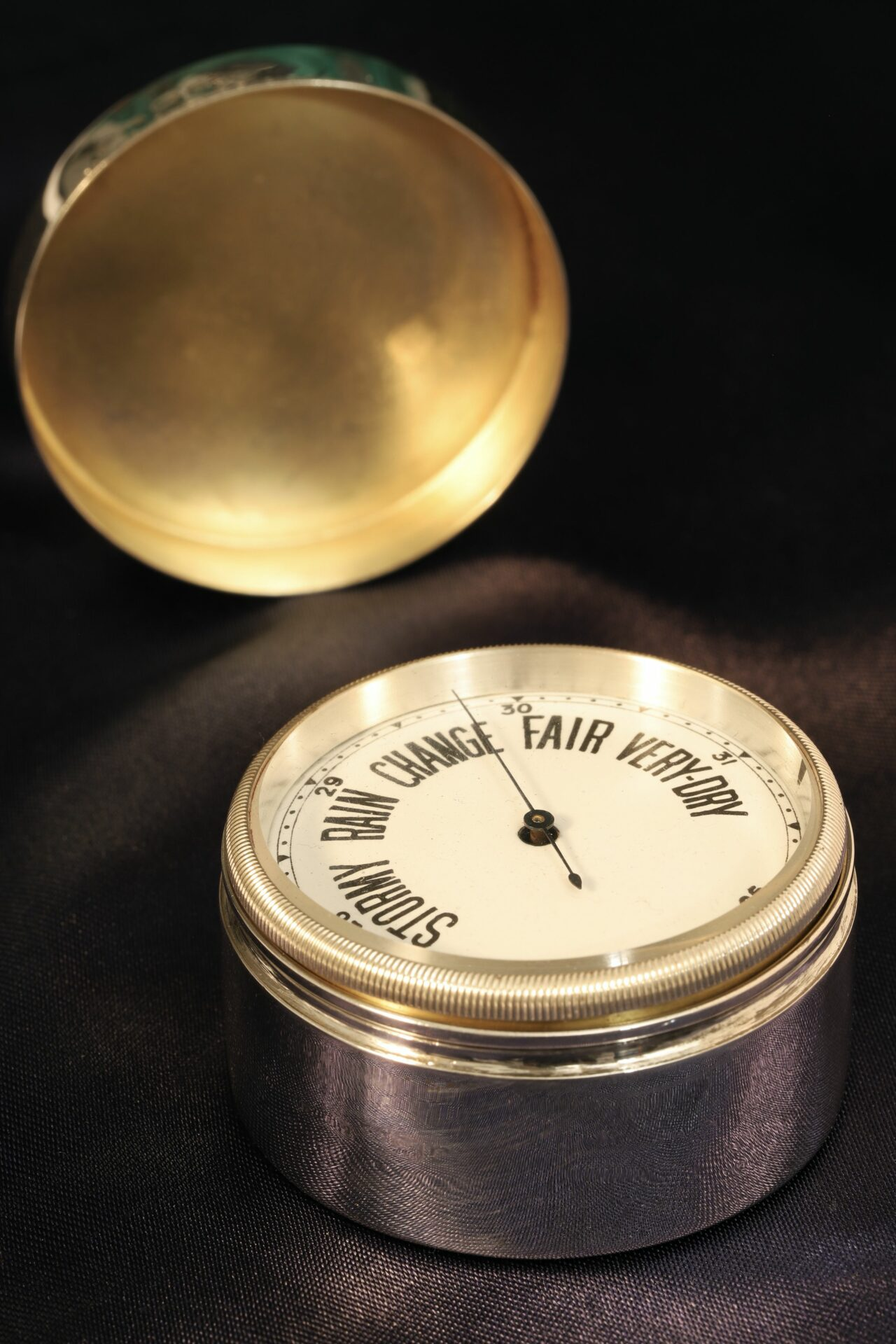 Image of open case of Silver Travel Barometer by Gourdel Vales c1900 showing barometer dial and silver gilt inner lid