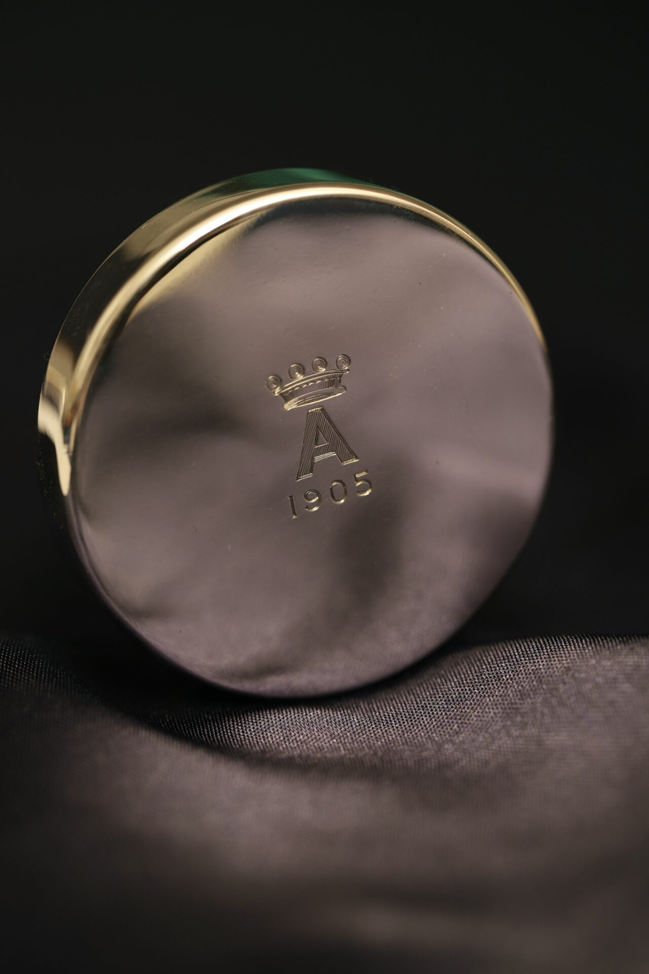 Image of lid of Silver Travel Barometer by Gourdel Vales c1900 showing monogram