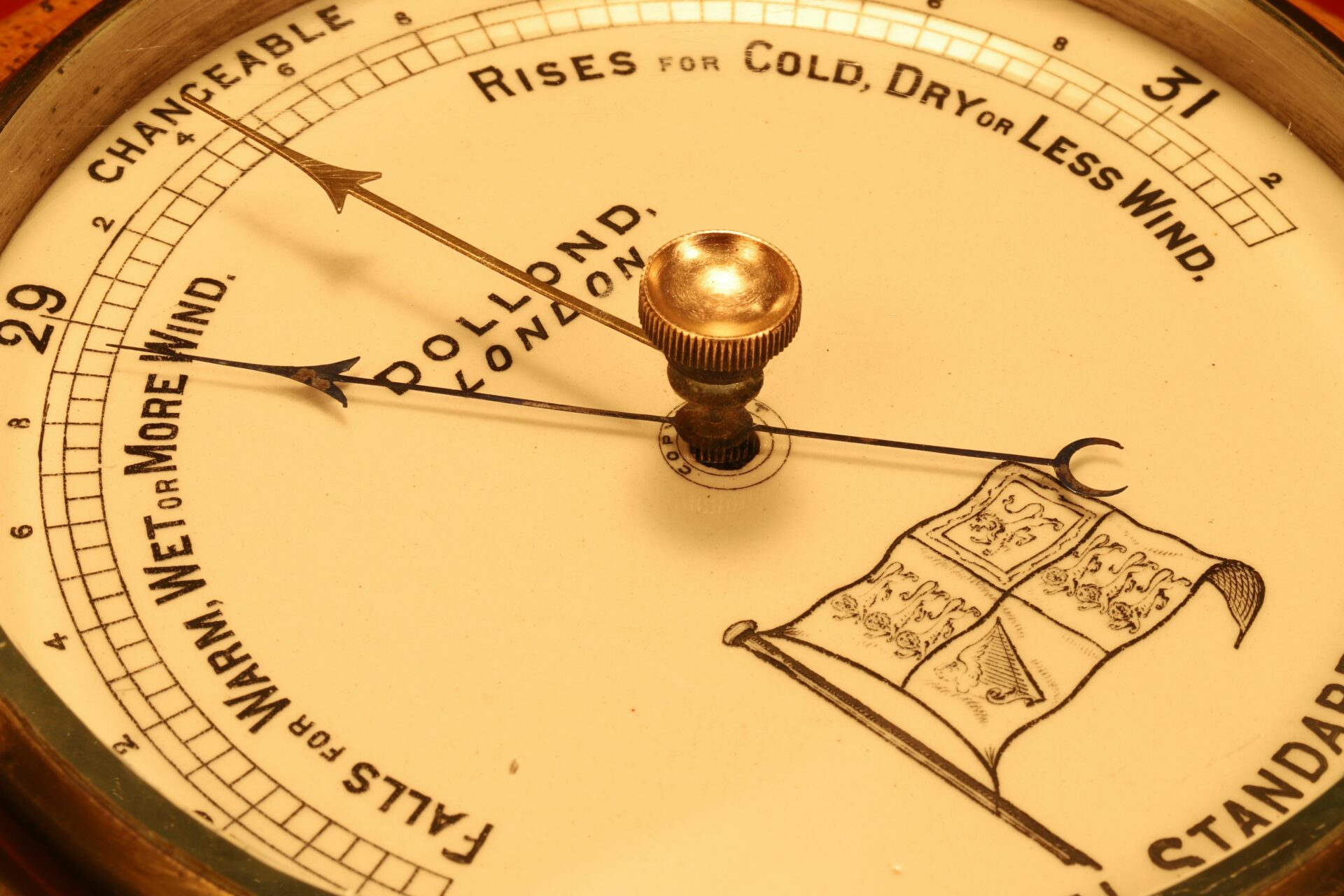 Image of dial of Dollond Royal Standard Marine Barometer c1880 taken from lefthand side