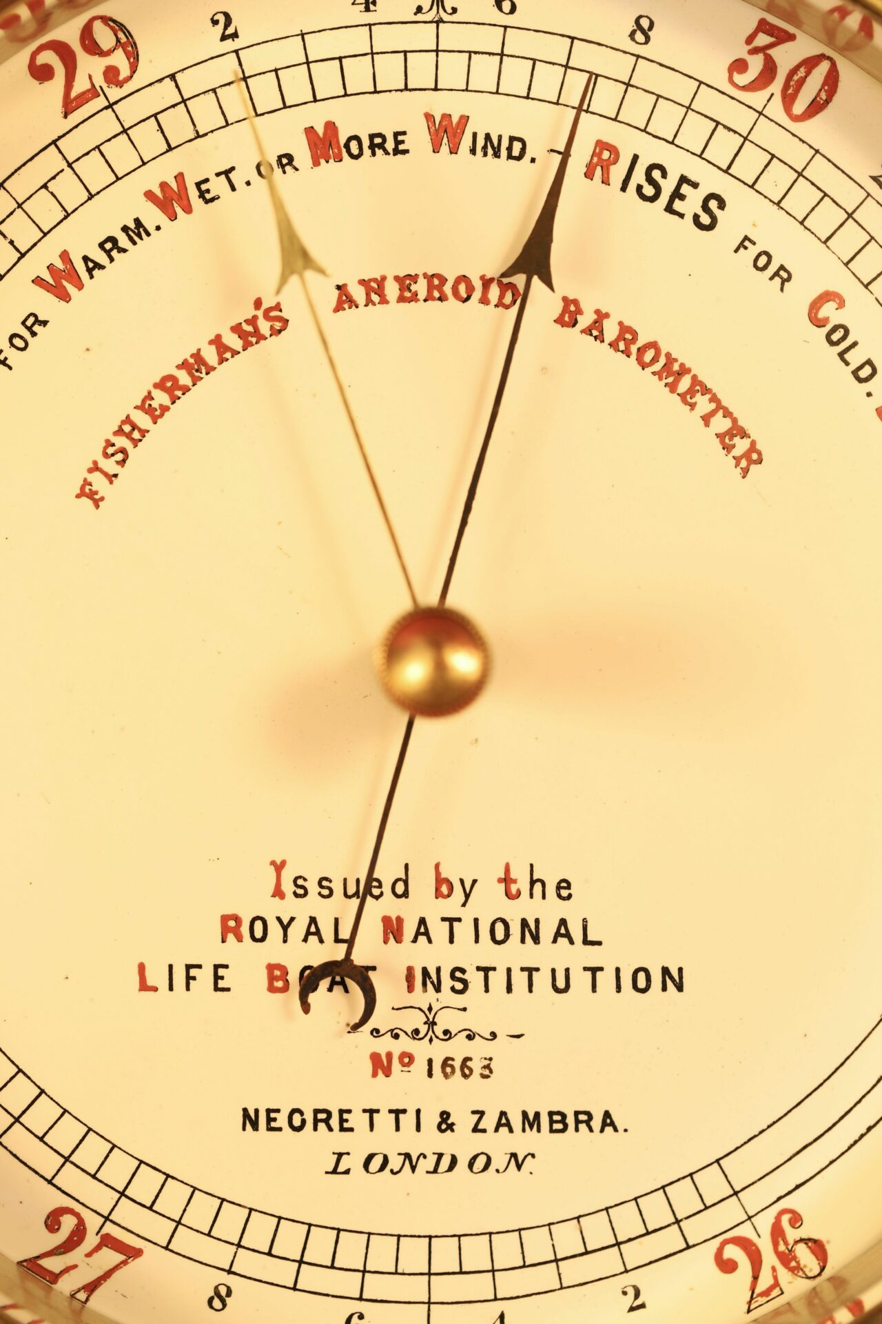 Close up of dial from Negretti & Zambra RNLI Fishermans Aneroid Barometer No 1663 showing pointer and telltale