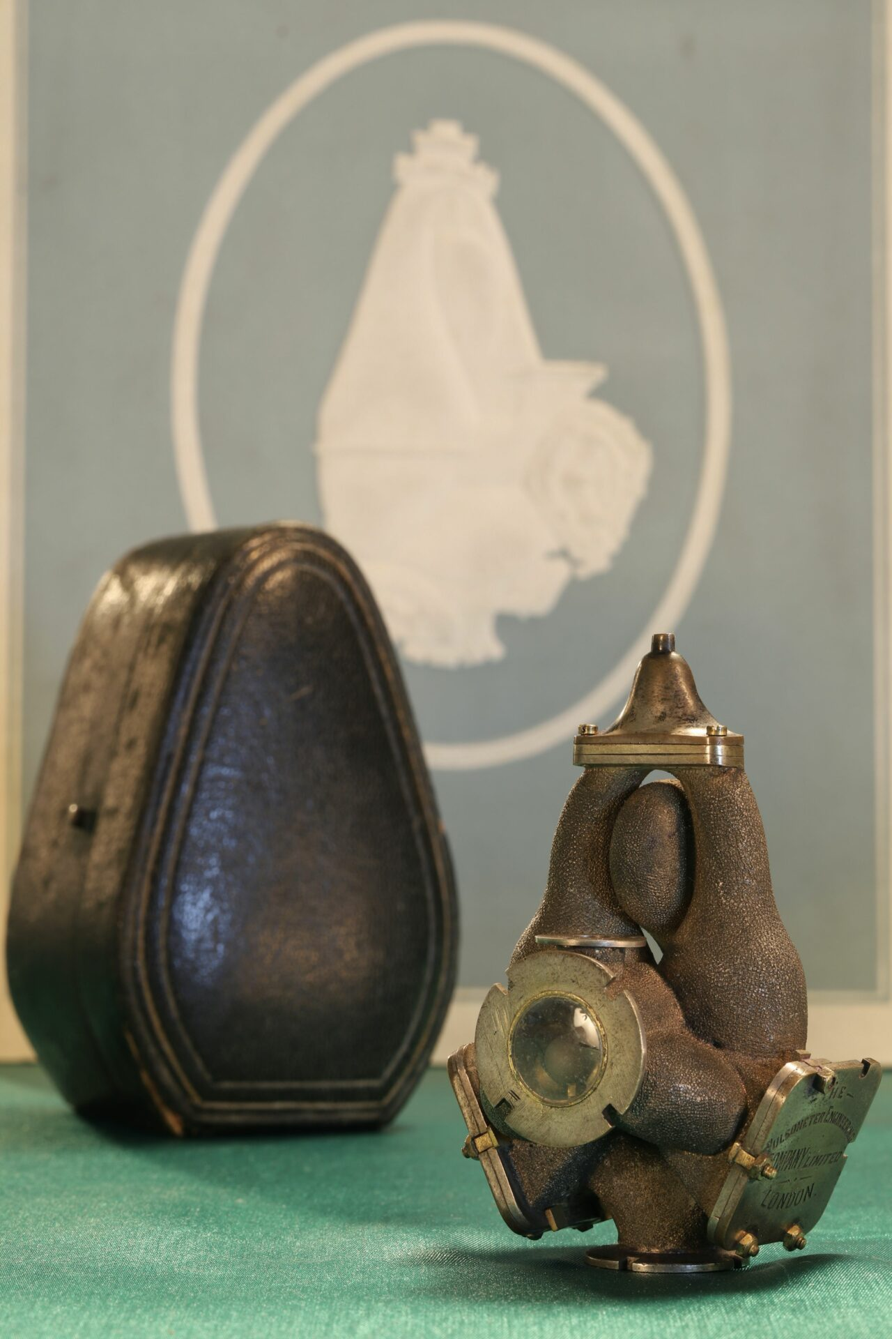 Image of front of Pulsometer Steam Pump Model c1905 taken from righthand side together with travel case and catalogue