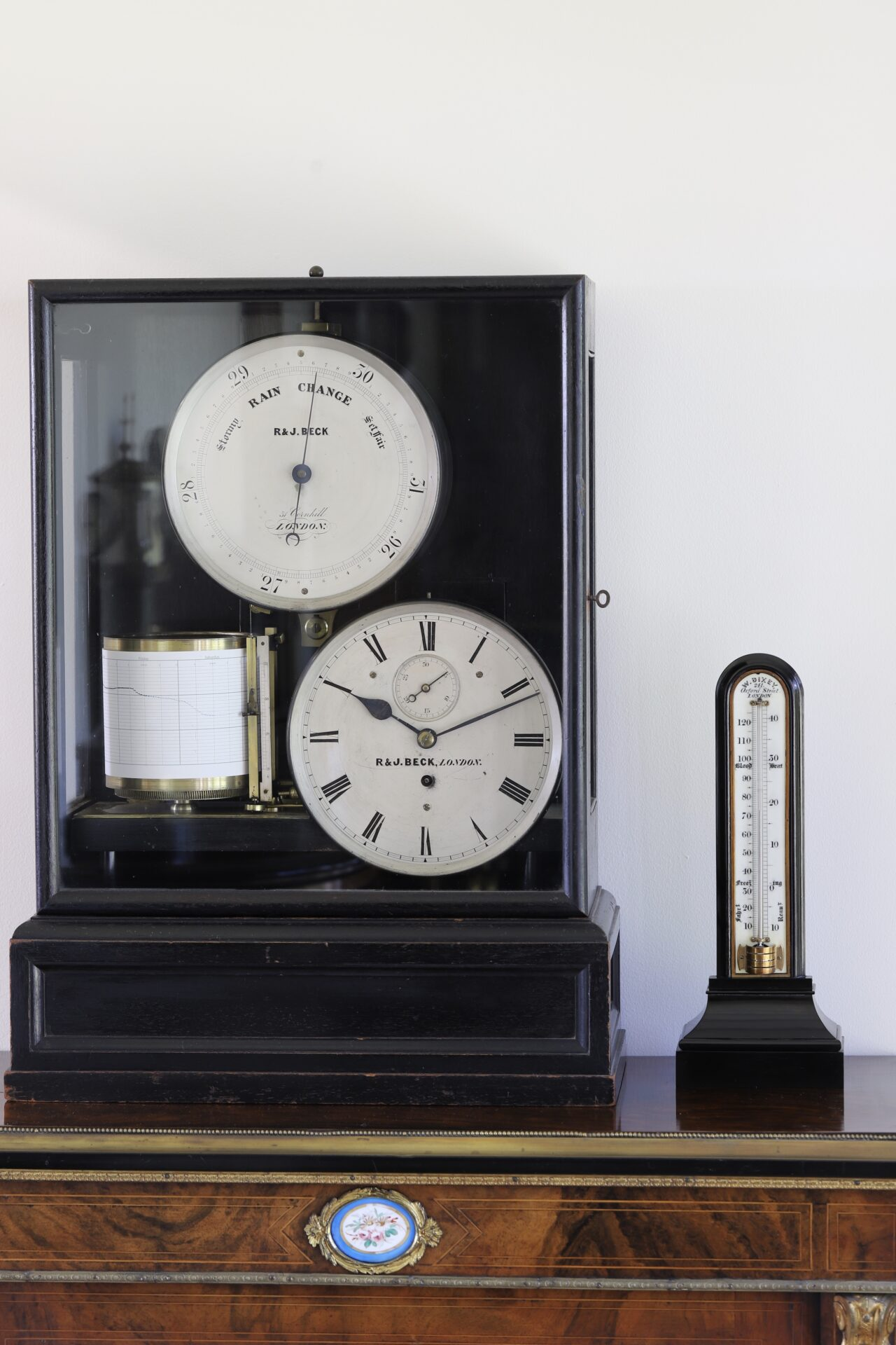 Front view of Victorian Thermometer in Ebony Case by William Dixey c1870 next to R&J Beck Weather Station