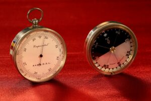 Image of pocket barometer and compass from Army & Navy COSL Pocket Barometer Compendium c1880