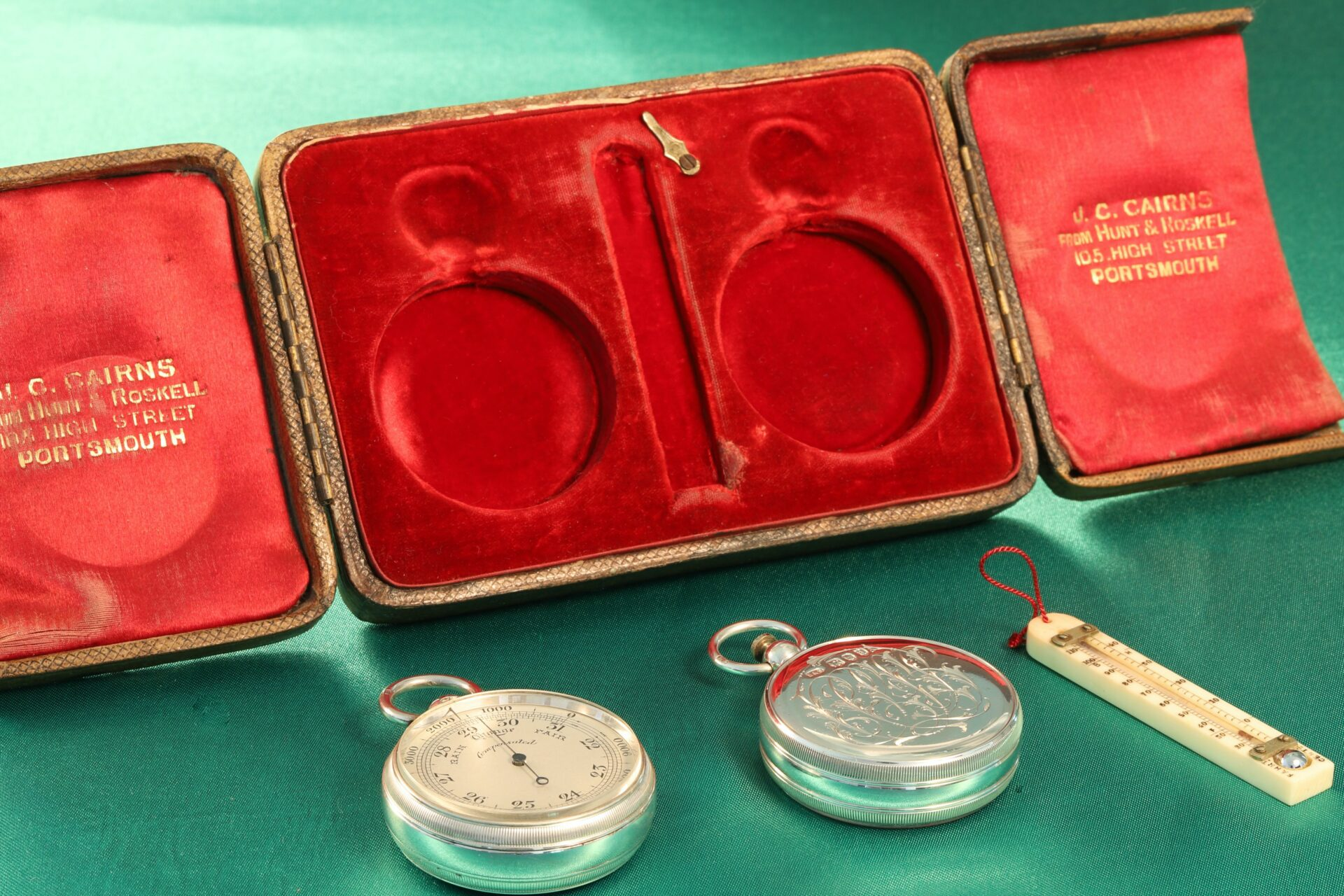 Image of pocket barometer, thermometer and compass with case from Cairns Silver Pocket Barometer Compendium c1892
