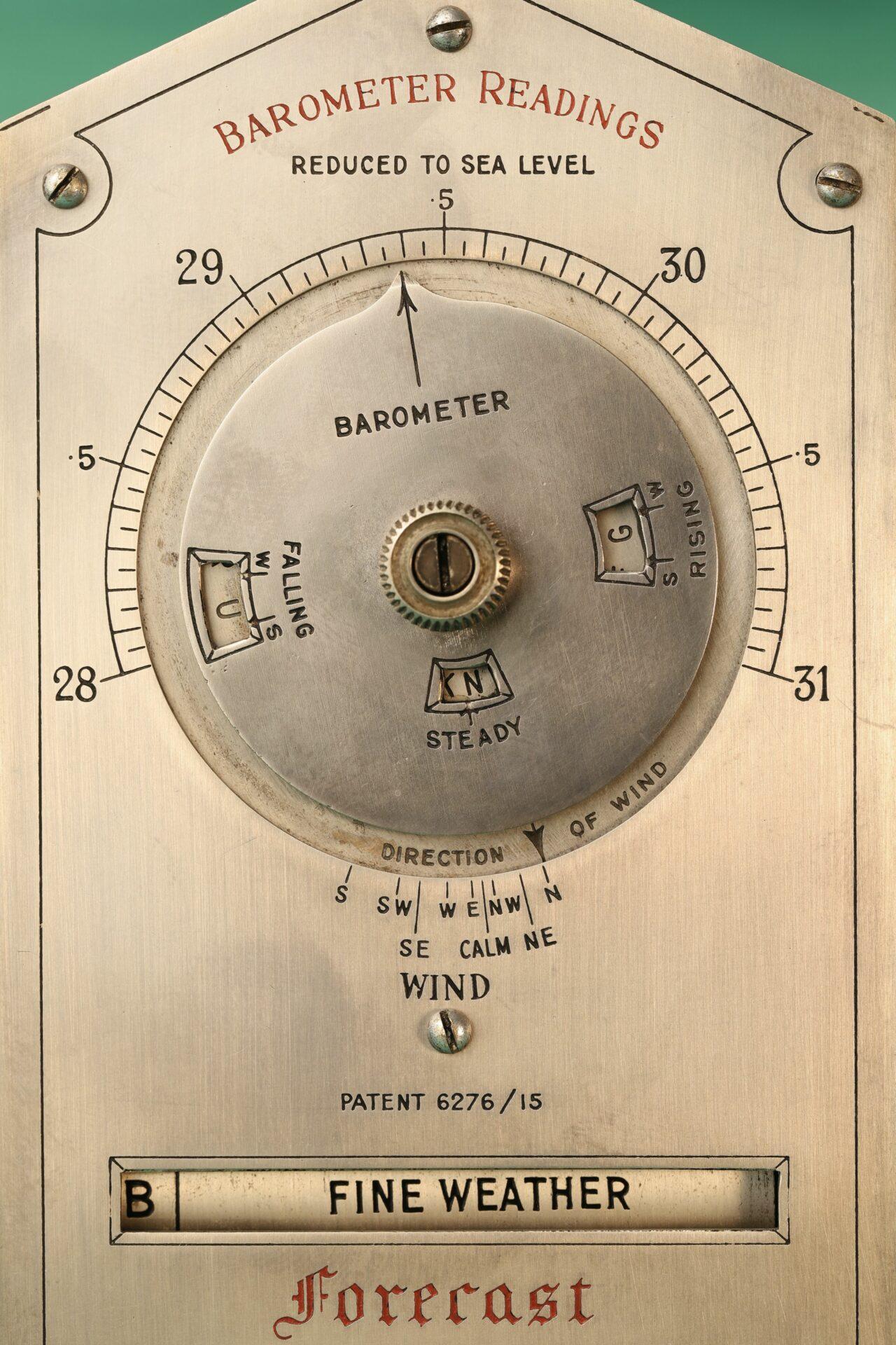 Close up of front of Negretti & Zambra Desk Forecaster c1915
