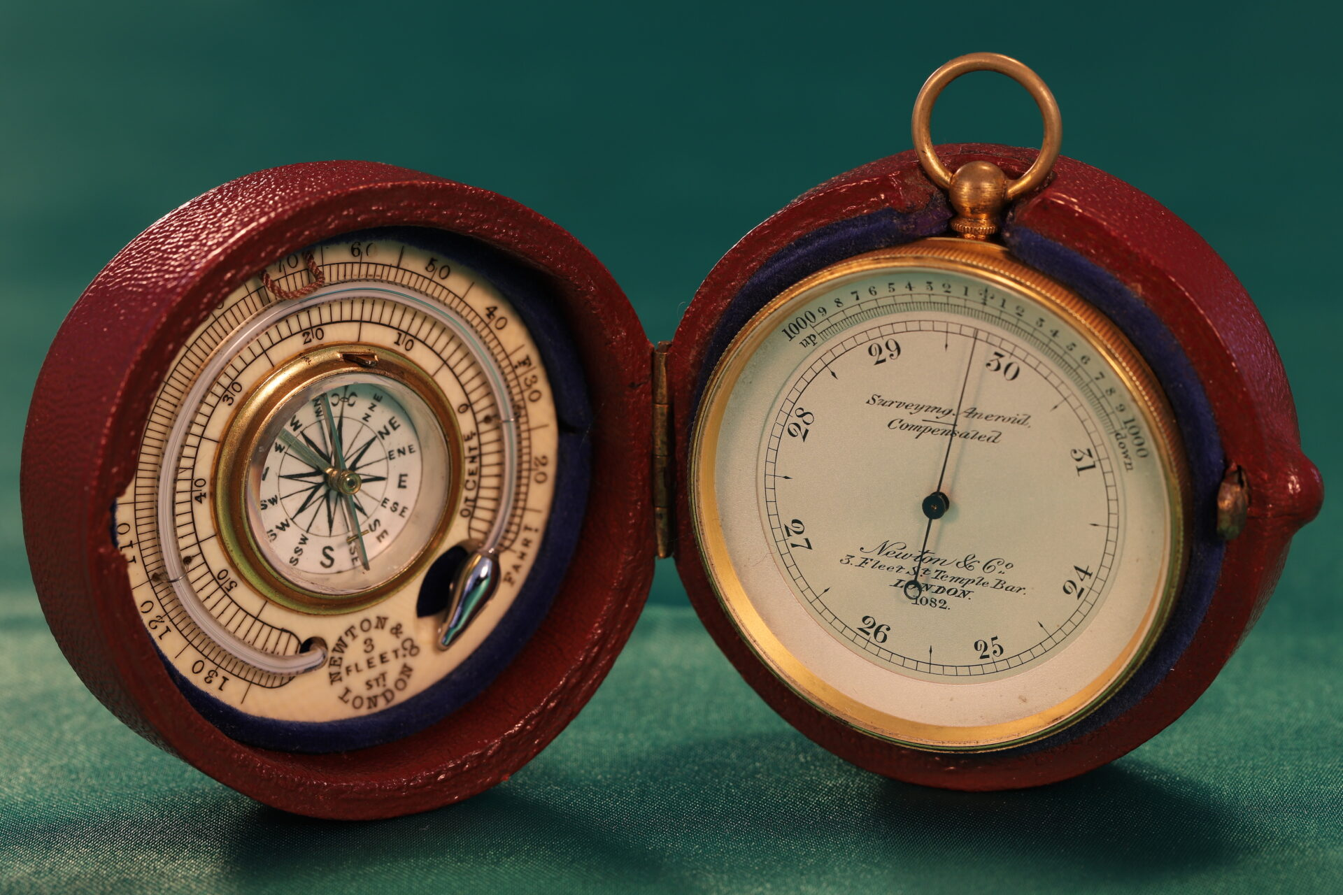 Image of Newton Pocket Barometer Compendium No 1082 in open case with compass and thermometer on left