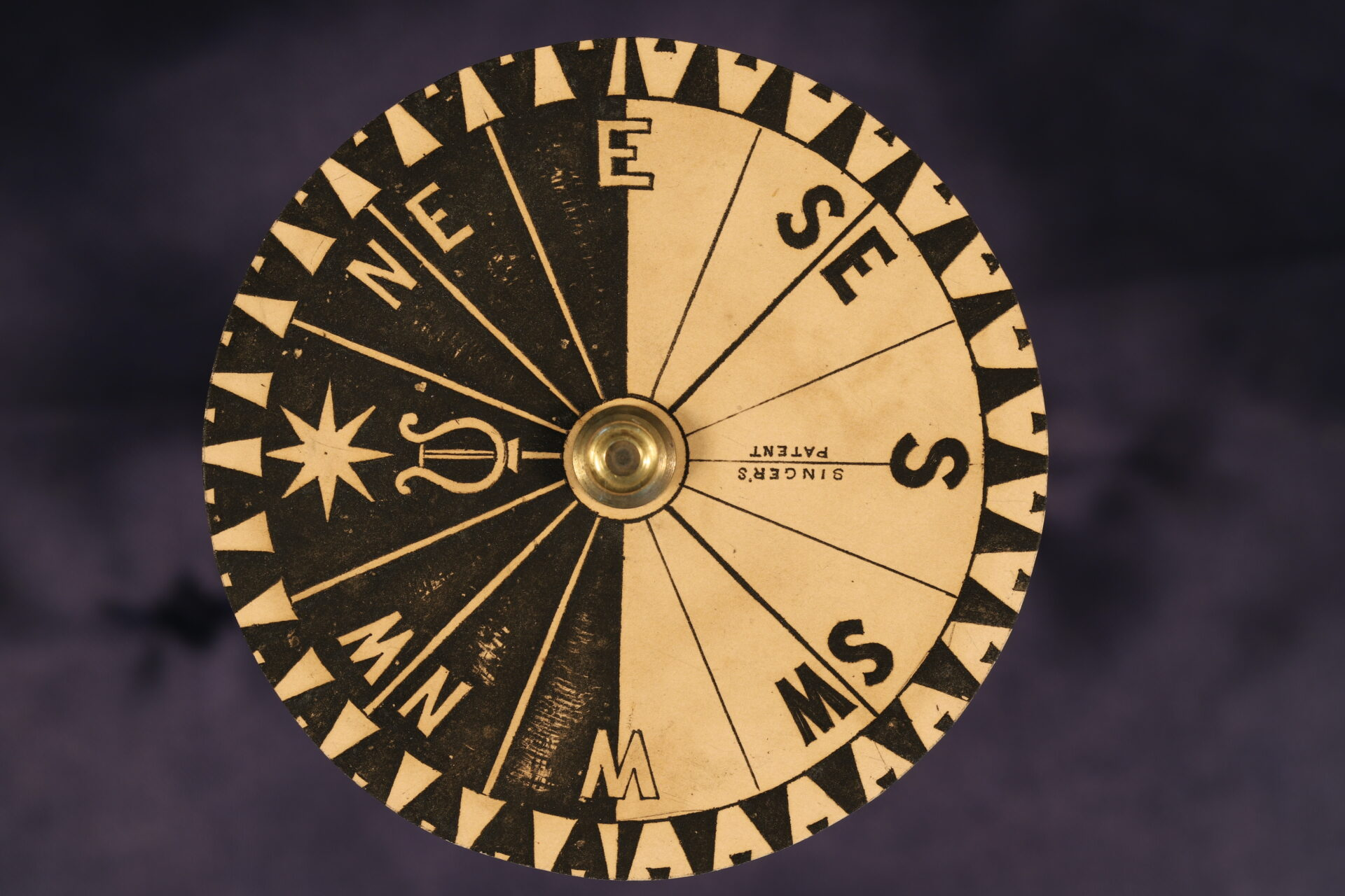 Image of hand drawn card for Explorers Singers Patent Compass c1870