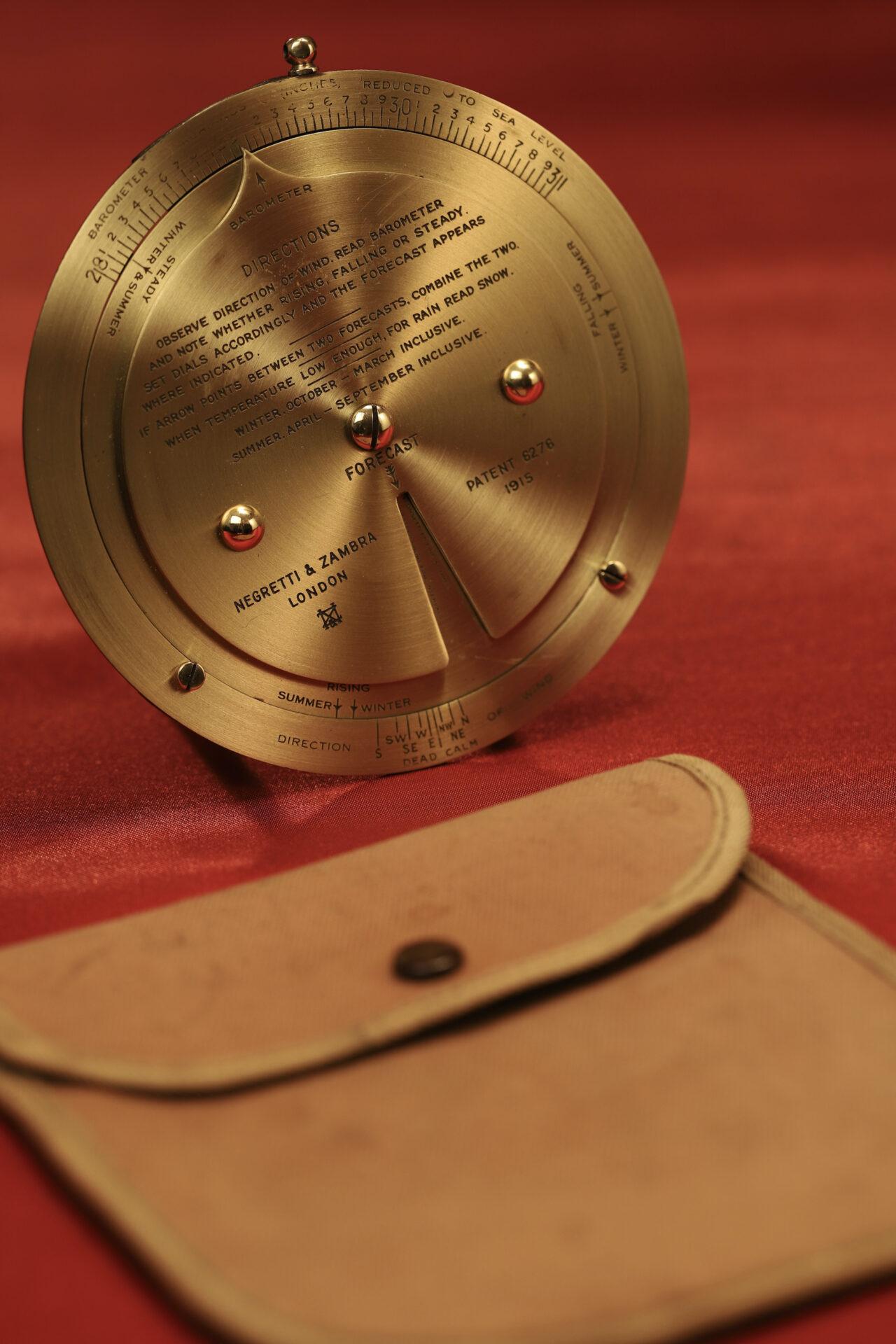 Image of Negretti & Zambra Brass Desk Forecaster with canvas case