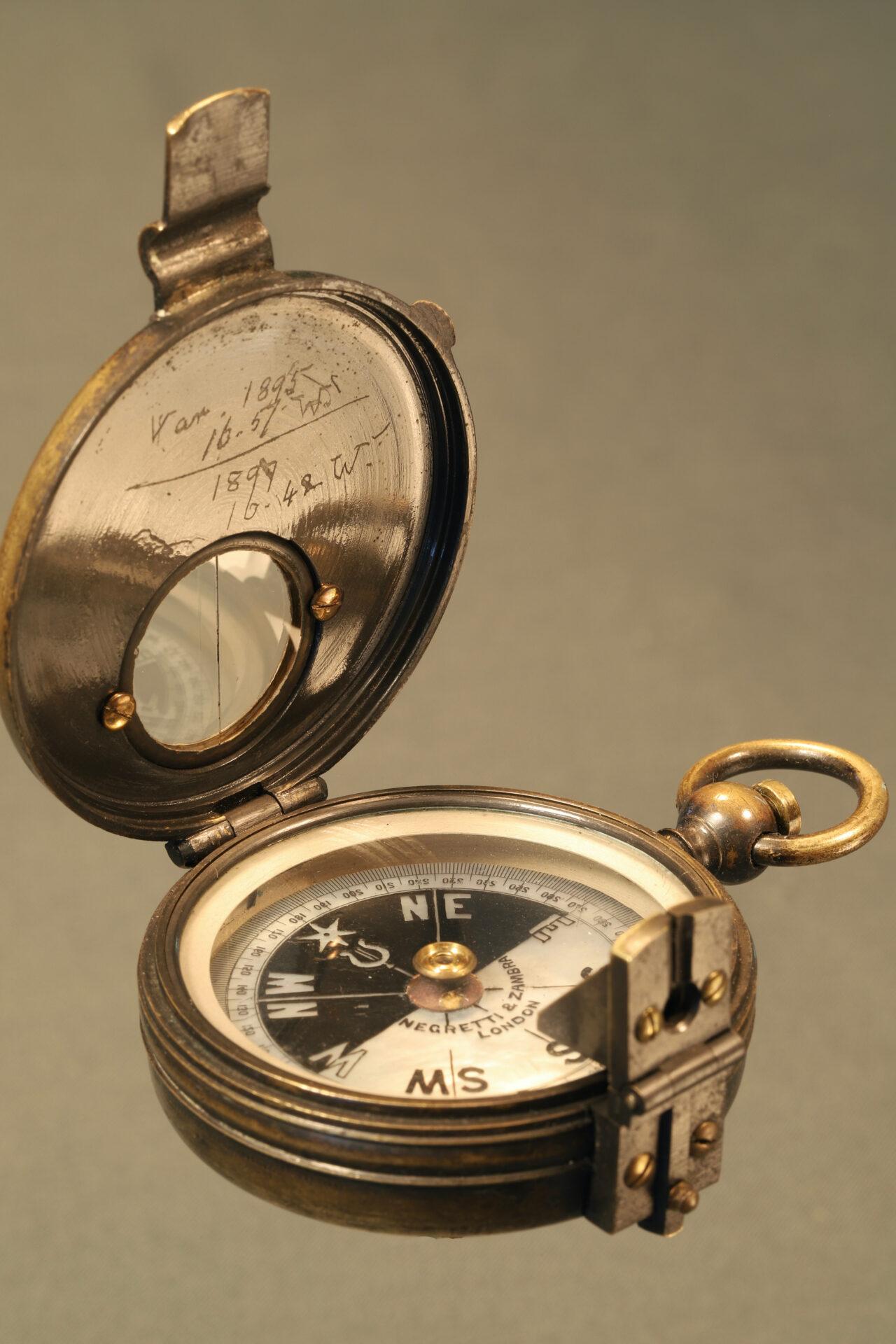 Image of open Negretti & Zambra Prismatic Compass c1895 taken from lefthand side