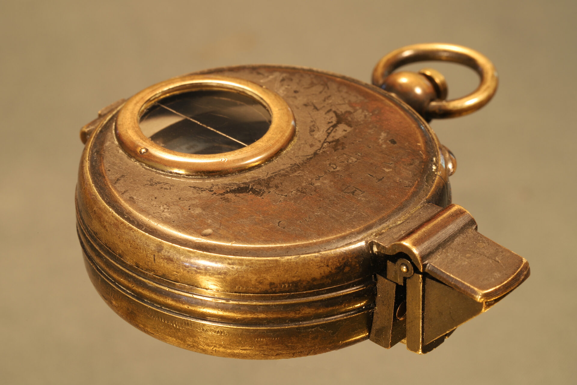 Image of closed Negretti & Zambra Prismatic Compass c1895 taken from lefthand side