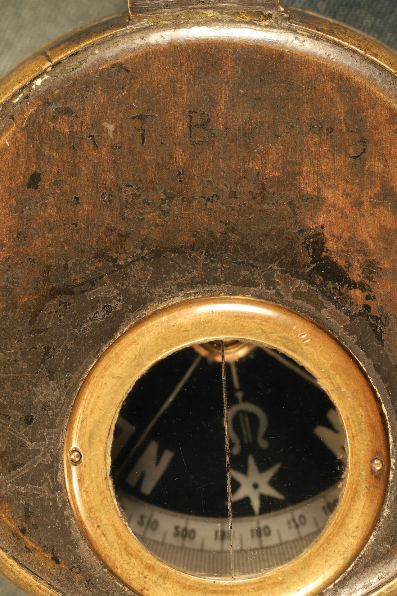 Close up of lid of Negretti & Zambra Prismatic Compass c1895 showing viewing port and inscription