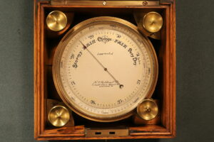 Close up of Short & Mason Chart Table Barometer c1906 in open case
